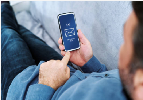 A man opening email on a cell phone